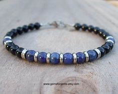 Mens 6mm Beaded Bracelet - Lapis Lazuli and Black Onyx For centuries, lapis lazuli was the most treasured gemstone of the ancient civilizations of the Mediterranean with its vivid deep blue color flecked with silver inclusions of pyrites, mined from the mountains of Afghanistan. I made