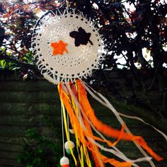 Here it is, an Autumn Wall Hanging/Dream Catcher... A hand crocheted doily middle, with some hand crocheted Acorns with Ribbons. The Maple leaf in the centre is thought to symbolise Unity, Tolerance and Peace https://www.etsy.com/uk/listing/249780140/dream-catcher-fall-decor-autumn?ref=shop_home_feat_2