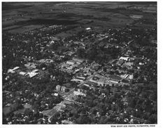 ID#0336 This aerial photo was taken of Oberlin in the mid 1960s. The Conservatory building has been constructed but there are a number of the buildings of Carpenter Court and College Place still standing. Participant:Oberlin College Archives