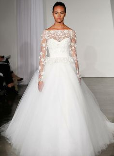 beautiful wedding dress with long sleeves and floral appliques