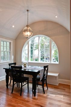 barrel vaulted ceiling with arched window