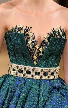 Fantastic details on this blue green dress.