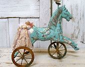 Painted wooden horse rusty wheels sea foam distressed decor French farm house wood sculpture Anita Spero