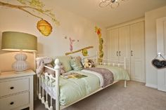 Pooh bear...can't go wrong. Bedroom from a showhome.