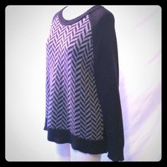 Michael Kors Patterned Sweater Black and gray long sleeve chevron patterned raglan sweater (I think cotton/acrylic but the content tag was removed). Cools shiny logo zipper at back neck. This is a size large from MICHAEL Michael Kors. Very good preowned condition MICHAEL Michael Kors Sweaters Crew & Scoop Necks