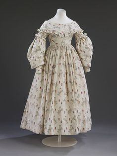 Sarah Maria Wright (1817-1908) m. Daniel Neal (1816-1907), a farm labourer in Lincolnshire, 27 July 1841, wearing this cotton colour-printed crazy gown. Silhouette is outmoded by 5years, but the fabric itself was immensely popular at the Sarah wore it. V&A T.27-2006