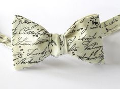 Made in a timeless treasures fabric called script - a bowtie that speaks for itself would make a great unique present .    size : 4.5 x 2.5 neck
