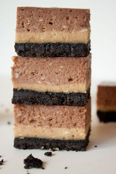 These peanut butter Nutella cheesecake bars are seriously rich. Silky layers of salty, peanut cheesecake and chocolate hazelnut cheesecake on an Oreo crust!