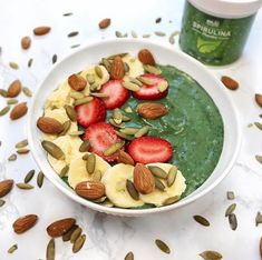 Smoothie bowl by @livemindfullyfit! ''I added frozen bananas with a teaspoon of spirulina, topped with fresh banana, strawberries, almonds and pumpkin seeds. Yum yum 😋•Spirulina has an insane amount of essential nutrients from the blue-green algae family. Check out @majusuperfoods instagram they have a bunch of other superfood health products on their website. (BTW: this isn't a paid sponsorship just sharing recommendations for good brands and what I enjoy!)'' ... #healthylifestyle…