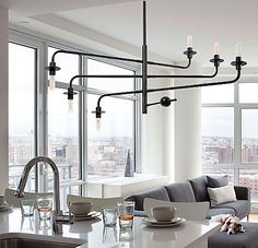 With the Sonneman Atelier Chandelier, you are the artist that creates the ideal configuration of light. Each of its arms swivels around the main stem, allowing you to arrange the exposed uplight and downlight at either end any way you