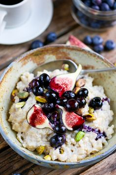 Brown Rice Porridge with figs, blueberries and pistachios. A healthy breakfast that's a little bit different.