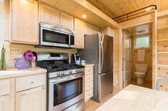 This is the Traveler XL Tiny House on Wheels! It's designed and built by ESCAPE TRAVELER. Please enjoy, learn more, and re-share below. Traveler XL Tiny House on Wheels – Video … Tiny Houses For Sale, Tiny House On Wheels, Mini Houses, Tiny House Living, Small Living, Shipping Container Home Builders, Luxury Cabin, Kitchen Stove, Kitchen Appliances