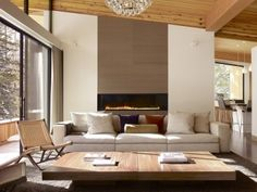 Nothing makes a room feel cozier than a fireplace. Whether it's modern, traditional, farmhouse or something altogether different, a living room that has a fireplace just feels more welcoming … House Design, Fireplace Design, Minimalist Fireplace, Living Room With Fireplace, Mid Century Living Room, Interior Design, Fireplace Surrounds, House Interior, Modern Fireplace
