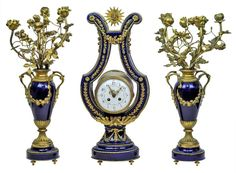 This lovely garniture in the French Louis XVI style dates from the late 19th to early 20th century. Clock measures 22.5 x 9 x 5.5 in and the candelbra 21 x 11 in.