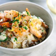 Spinach and mushroom risotto with garlic shrimp recipe is a elegant one bowl meal! Creamy arborio rice is mixed with vegetables, topped with tender shrimp.