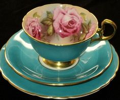 Such a beautiful teal tea cup & saucer with the cup lined with pink roses. (These remind me of my grandmother, she had a beautiful collection of bone china cups with saucers. China Tea Cups, Teapots And Cups, My Cup Of Tea, Chocolate Pots, Tea Cup Saucer, High Tea, Afternoon Tea, Tea Time, Tea Party