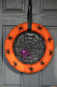 DIY Fun Halloween Wreaths!-- I like the idea of the web in the middle
