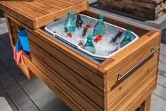 Take your outdoor entertaining up a notch with this rolling serving center. It holds a cooler plus offers shelf space for other items. The sliding top covers everything up when not in use, and it can still be used when open. Made from cedar, this project will serve you in style for years.