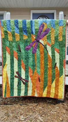 Kathy almost gave up on this beautiful dragonfly quilt which was a gift to her daughter, but we're so glad she didn't! The custom pattern and appliqued dragonflies and cattails work together perfectly. And the freehand quilting on her APQS Millennium longarm machine added the finishing touches. Great work, Kathy!