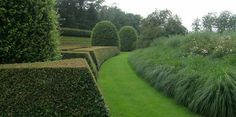 Jacques Wirtz: contrasting formal hedges and soft ornamental grasses. Both provide great structure all year round.