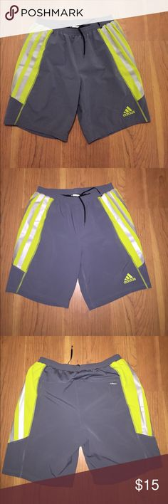 Men's adidas Running Shorts Men's reflective Adidas Adizero Climacool, Running shorts.  Size medium.  Gently used, but still look great.  Gray and fluorescent yellow color with gray reflective stripes.  Built in liner.  Tag cut out. adidas Shorts Athletic