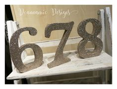 Gold glitter numbers and word signs. Table Name Cards, Table Names, Gold Invitations, Gold Glitter, Numbers, Symbols, Signs, Gold Save The Dates, Icons