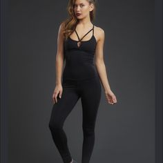 Zobha black unitard leggings Cutest workout outfit ever!   Ordered this in a size too big.  If you're a larger size 6 to size 8, this will fit like a dream.  Also consult with Zobha.com to check size chart.   Currently being sold full price online. Zobha Other