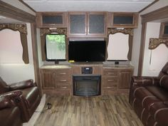 "2016 Keystone Cougar 327RES Fifth Wheel Lexington, KY Northside RVs You can also choose an optional fireplace for those cool chilly nights. entertainment center with 40"" LCD TV, overhead and lower cabinet storage both above and below, plus along each side of the TV."