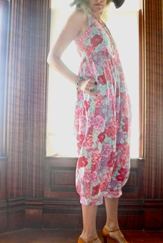 this is a beautiful rare vintage laura ashley floral jumpsuit summer romper. can be dressed up or down. great blend of reds and pinks with a touch of green.