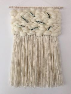 Woven wall hanging with hand braided detail