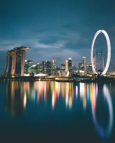 singapore The skyline at Marina Bay. Note the Marina Bay Sands to the left, and the Singapore Flyer to the right of the image. Singapore Photos, Singapore Travel, Marina Bay Sands, Photographie New York, Stock Photo Sites, Futuristic City, Padang, Destination Voyage, Honeymoon Destinations