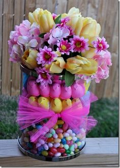 Easter Peep Arrangement~ Layer jelly beans, peeps for that holiday and and then a smaller vase with water for the flowers, set right inside the top of the large vase. Now you have a great holiday centerpiece.
