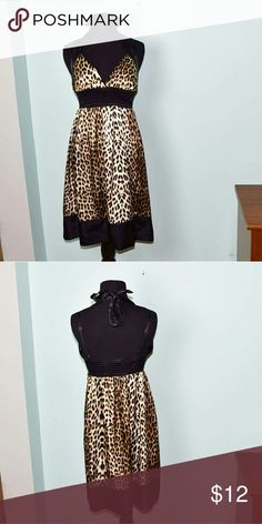 Sexy Leopard Print Silky Dress In excellent condition! Very eye catching and sexy! Buy 3 items and get 1 free plus 15% off your purchase total! Dresses Midi