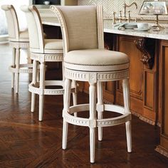 Enhanced with elegant details and individually applied nailhead trim, Manchester's solid-birch hardwood frames are now available in four rich, hand-rubbed finishes. Leather or linen upholstery complement the stool's classic lines. Imported.