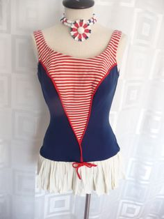 1960s red, white, and blue skirted bathing suit. Too cute.