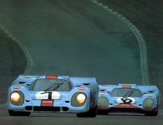 theracing:  Gulf Porsche 917k of Rodriguez / Oliver (7) Siffert / Bell (6) at B.Hatch 1000km, 1971