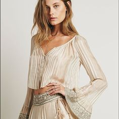 NWT Free People Set NWT gorgeous Free People skirt and blouse set. perfect for coachella!!!! Please note the skirt does not come with the short liner that is seen in the picture. This is such a romantic set! Free People Skirts Maxi