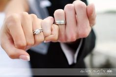 Pinky swear showing off the wedding or engagement rings