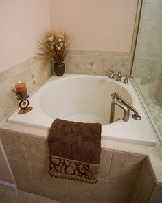 Contemporary Japanese Soaking Tubs: Contemporary Japanese Soaking Tubs With Small Brown Towel And Gray Faucet Design And White Ceramic Soaking Tubs