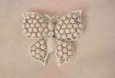 Always something exciting in store many items on sale from 10 to 60% off Beautiful Milk glass white enamel Butterfly Brooch