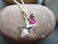 Swarovski star necklace with sparkly Swarovski crystal beads in shades of pink. This is a very pretty pendant charm necklace, ideal for any