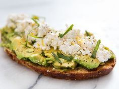 This open-faced sandwich pairs avocado with Italian flavors like creamy ricotta, extra-virgin olive oil, bright lemon zest, and fragrant basil. A squeeze of lemon juice cuts through the avocado and keeps the whole thing tasting light and summery, no cooking required.