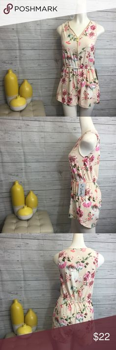 "J for Justice medium floral short romper blush NWT J for Justice size medium short romper, sleeveless, zipper front, elastic at waist. Blush, floral print. 92% Polyester 8% Spandex. Bust 17"" armpit to armpit Waist 13 1/2"" side to side Length 28 to 31"" shoulder to hem Waist to hem 12 1/2"" to 14 3/4"" Measurements are approximate. J for Justice Other"