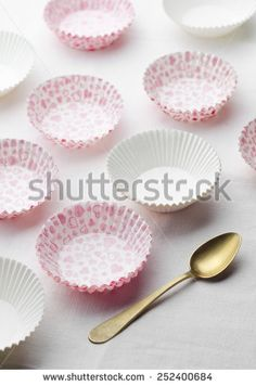 Colored empty cup cakes over white cloth