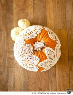 Glue doilies ont pumpkins and I'd add some fall leaves to top around stem. #FallDecor #ThanksgivingDecorations