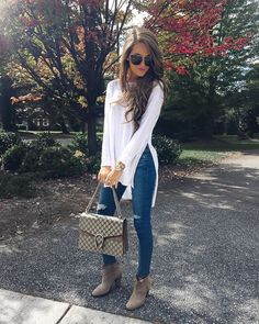 I feel like I could 100% pull his outfit off because we are about the same body type. Love the white top with the slit. Cute with skinnies and booties.