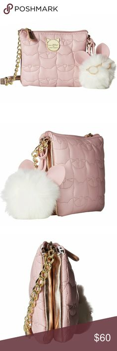 """🌹NWT- BETSEY JOHNSON BLUSH KITTY CROSSBODY! 🌹NWT- BETSEY JOHNSON BLUSH ROSE KITTY 3 COMPARTMENT CROSSBODY BAG! This triple compartment brand new crossbody bag by Betsey Johnson offers quited design & removable charm, 3 serperate pouches with zipper closures & flat base.    Measurements: Bottom Width: 7"""" Depth: 1"""" Height: 6"""" Strap L: 50""""  🌹NWT- BRAND NEW WITH TAGS 🌹100% AUTHENTIC 🌹BUNDLE & SAVE / NO TRADES/ NO HOLDS 🌹OFFERS ACCEPTED THROUGH THE OFFER BUTTON ONLY  🚫PLEASE FOLLOW CLOSET…"""