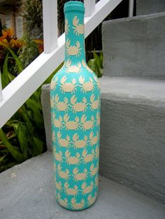 cool idea... painted wine bottle... crabs punched out of a manila folder, glued on and sealed