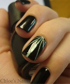This is so cool, I have to try it! The effect is created by placing very thin strips of tape on top of an already polished nail, then add a coat of another color on top of that, then remove the tape - easy!