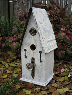 Wood Birdhouse with a vintage glass doorknob for perch.